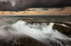Dramatic waves at sunset in Kudat, Sabah Borneo, East Malaysia Royalty Free Stock Photo