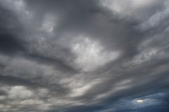 Dramatic wavy clouds in a stormy whether stock images