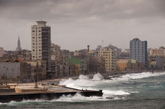 Dramatic weather with big waves at cuban Malecon. Havana, Cuba Royalty Free Stock Image