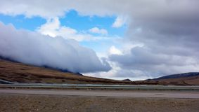 Dramatic weather rolling across the arctic in the springtime. The summit of an alaskan mountain range along the famous dalton highway Royalty Free Stock Images