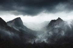 Dramatic weather on Sanadoire and Tuilière rocks in Auvergne province - France royalty free stock images
