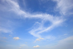 Dramatic white clouds on blue sky Stock Photo