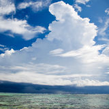 Dramatic white cumulus cloud formation. Dramatic towering white cumulus cloud formation over the coastline and ocean in a blue sunny sky Stock Photography