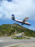 Dramatic Winair plane landing at St Barth airport. ST. BARTHS, FRENCH WEST INDIES - JANUARY 21:Dramatic Winair plane landing at St Barth airport on January 23 royalty free stock photography