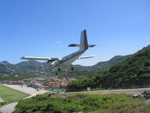 Dramatic Winair plane landing at St Barts airport Royalty Free Stock Photography