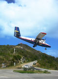 Dramatic Winair plane landing at St Barts airport Stock Photo