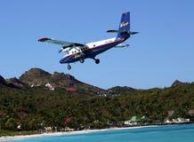 Dramatic Winair plane landing at St Barts airport Royalty Free Stock Photography