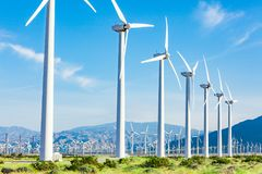 Dramatic Wind Turbine Farm in the Desert of California. Dramatic Wind Turbine Farm in the Desert Fields of California Stock Images