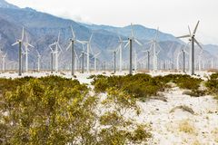 Dramatic Wind Turbine Farm in the Desert of California. Stock Photos