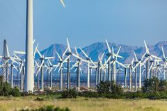 Dramatic Wind Turbine Farm in the Desert of California. Royalty Free Stock Photo