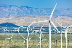Many Wind Turbine Farm in the Desert of California. Dramatic Wind Turbine Farm in the Desert Mountains  of California Stock Images