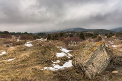 Dramatic winter landscape with foggy mountain and a big stone. Russia, Stary Krym. royalty free stock photo