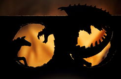 Dragon. And horse figures in contrast on a yellow background Stock Images