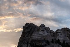 A dramatic Sky Behind Mount Rushmore. A dramatically colorful sky developing around sunset behind the four US presidents of Mount Rushmore, in North Dakota royalty free stock photos