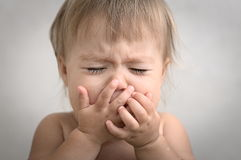 Dramatically crying baby portrait. Dramatically with creaming crying baby portrait very emotional Stock Image