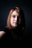 Dramatically lit portrait of a red haired teen Stock Image