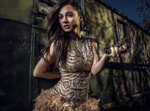 Dramatized image of sensual & attractive young woman in luxury dress posing outdoors. Stock Photos