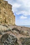 Dramatyczny portreta widok falezy przy zachód zatoką, Dorset Zdjęcia Royalty Free