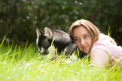 Draming girl with her husky Stock Photography