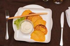 Draniki - potato fritters. potato pancakes with pumpkin. The naitonal dish of Belarus, Ukraine and Russia royalty free stock photos