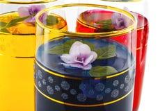 Drank drie kleuren van bloemen, blauw close-up, Stock Afbeeldingen