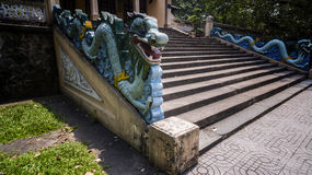 Draons protect entrance at old Buddhist shrine Stock Images