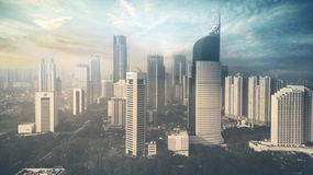 Drapacze chmur przy zmierzchu czasem w Dżakarta Zdjęcie Stock