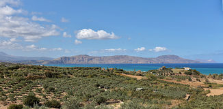 Drapano peninsula on Crete. View across north crete to the Drapano Peninsula, with olive groves and the Aegean Sea in the foreground Royalty Free Stock Images
