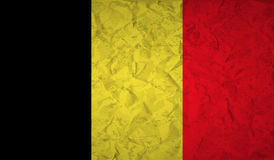 Drapeau belge avec l'effet du papier et du grunge chiffonnés illustration de vecteur