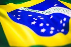 Drapeau brésilien avec la vue de côté image stock