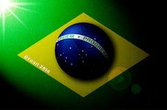 Drapeau brésilien dessiné sur le champ avec du ballon de football 3D Photo libre de droits