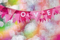 Drapeau d'amour sur le fond de bokeh Images stock
