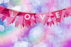 Drapeau d'amour sur le fond de bokeh Photos libres de droits