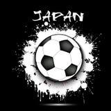 Drapeau de ballon de football et du Japon Photo stock