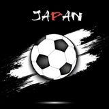 Drapeau de ballon de football et du Japon Photos stock
