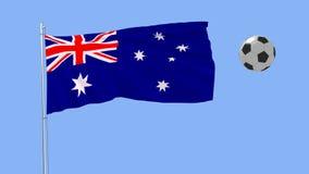 Drapeau de flottement réaliste de l'Australie et du ballon de football volant autour sur un fond bleu, rendu 3d Images libres de droits