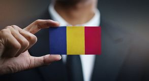 Drapeau de Holding Card Romania d'homme d'affaires photo stock