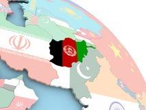 Drapeau de l'Afghanistan sur le globe Photographie stock libre de droits