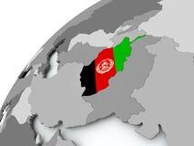 Drapeau de l'Afghanistan sur le globe gris Photos libres de droits