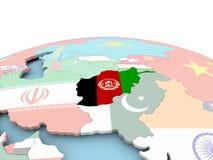 Drapeau de l'Afghanistan sur le globe lumineux Images libres de droits