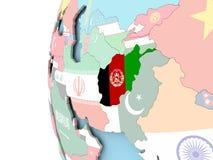 Drapeau de l'Afghanistan sur le globe politique Photographie stock