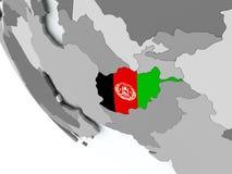 Drapeau de l'Afghanistan sur le globe politique Image libre de droits