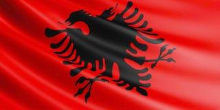 Drapeau de l'Albanie flottant en vent Photographie stock