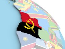 Drapeau de l'Angola sur le globe Photographie stock