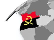 Drapeau de l'Angola sur le globe gris Image stock