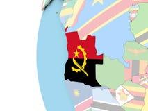 Drapeau de l'Angola sur le globe politique Images stock