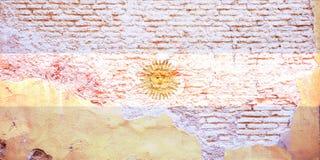 Drapeau de l'Argentine peint sur un mur de briques illustration 3D Photos libres de droits