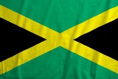 Drapeau de l'ondulation de la Jamaïque photographie stock libre de droits
