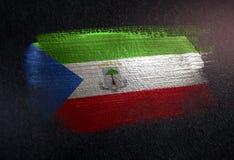 Drapeau de la Guinée équatoriale fait de peinture métallique de brosse sur le grunge DA illustration de vecteur