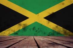 Drapeau de la Jamaïque sur le mur photographie stock